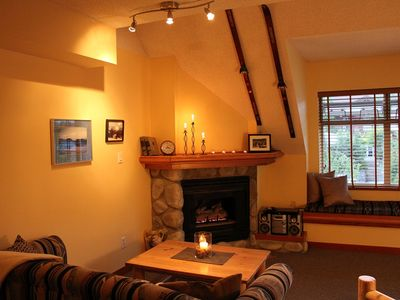 High vaulted ceilings with a river rock fireplace