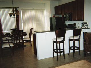 Compass Bay townhome photo - Breakfast Bar, Kitchen and Dining Room