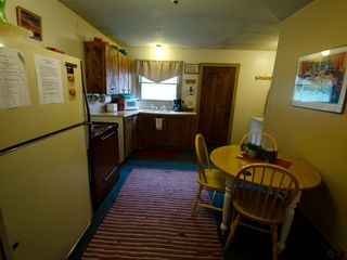 Missoula cabin photo - kitchen area and washer and dryer to right behind table area.