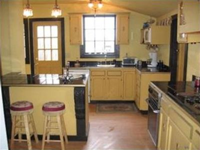 Kitchen with Island & second sink, hand painted tile stove back, breakfast nook