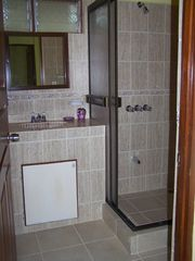 Playa Flamingo condo photo - Adjoining bathroom for second bedroom. Totally new from ceiling to floor!