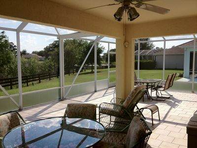 A portion of the lanai is also covered by a full roof with a ceiling fan.