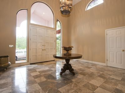 Grand formal entry with marble floors.