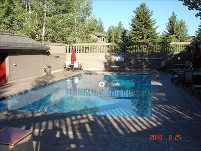 Year-round pool with diving board, adjacent sauna and bathrooms/changing area