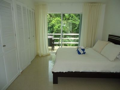 2 nd Bed room upstairs with balcony and garden view