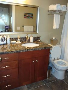 Bathroom with plush towel and bathrobes
