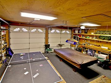 Heated Garage and game room with pool and Ping Pong.