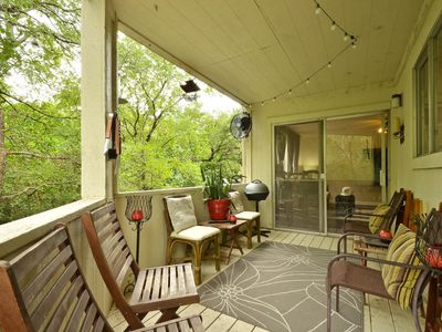Relax on the upstairs balcony and enjoy views of trees