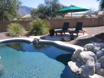 Pool and chaise lounges
