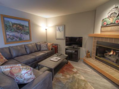 C213 Cinnamon Ridge - a SkyRun Keystone Property - Living Room - The living room has a gas burning fireplace and a TV.