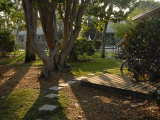 Sanibel Island cottage photo - The Pool - just steps away. Tennis court just around corner to the left.