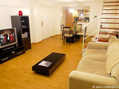 Living room has a comfortable sofa bed, 36' LCD TV, DVD, Apple TV and Wi-Fi @