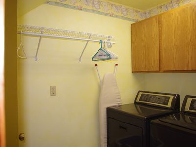 Full service Laundry Room with large capacity washer, dryer, ironing board/iron