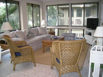 Enclosed Sunroom overlooking the Golf Course is the Best Place to Relax.