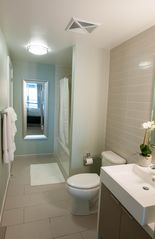 Toronto condo photo - Large en suite bathroom with washer and dryer for your convenience.