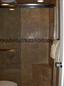 Remodeled bathroom in Maui vacation rental. Towels and beach towels provided.