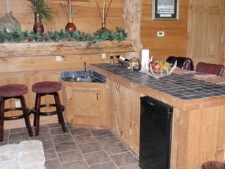 Lake Toxaway house photo - Full wet bar with seating throughout. Small Frig. for those cold drinks!