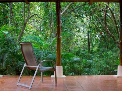 Looking out your front door, you see one of Costa Rica's famous natural reserves