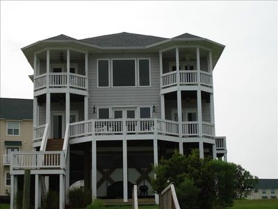 sound front view of home w/private dock & balconies