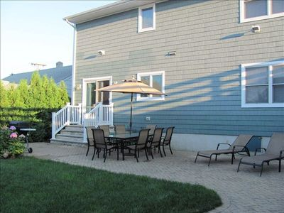 Beautiful Pavered patio area with seating for approx. 10 to 12. BBQ and shower.