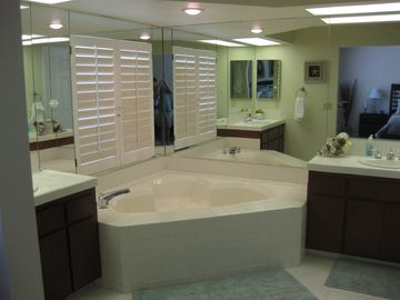 Master bathroom. Two sinks separate shower and tub