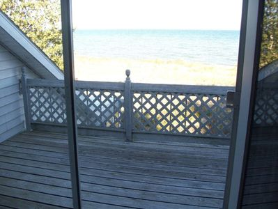 View of balcony and lake from upstairs bedroom