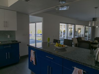 Kitchen with views of the pool across the breakfast bar