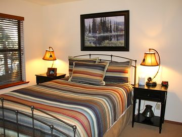 Mountain Getaway: Queen bed, two large windows, closet and dresser.