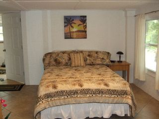 Bedroom in downstairs apartment w/queen size bed & in-room TV with full bathroom