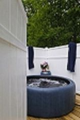 Flat Rock cottage photo - Private hot tub area.