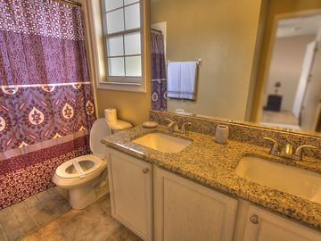 Upstairs Bathroom with double sink and granite counters