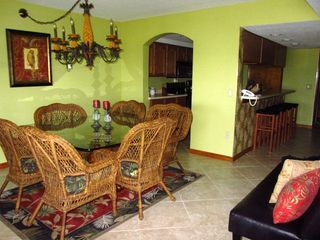 Dining area with large chairs - Cocoa Beach condo vacation rental photo