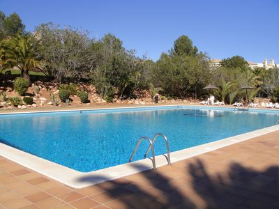 Solar heated swimming pool just one minute walk from the apartment.