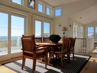 Truro house photo - Beautiful dining room for 8 with bay views.