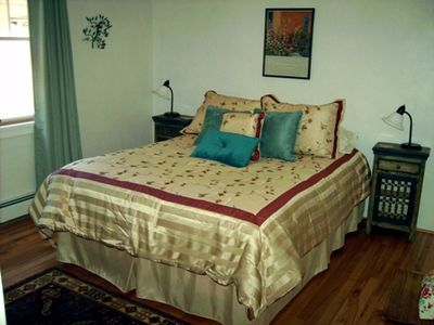 queen bed in back bedroom
