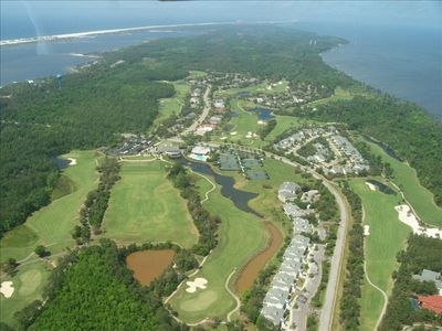 Huge condo on the golf course at Peninsula.  Short drive to town and the beach