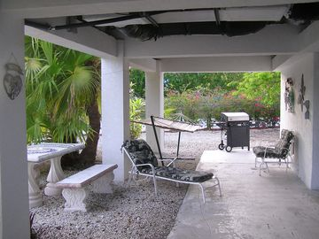 Lower Patio Area with Grill, Lounge Chairs and Hammock