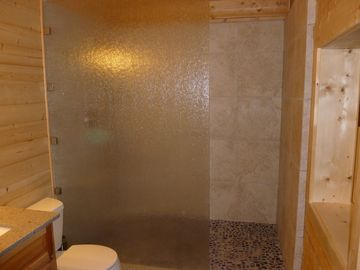 Luxurious shower w/ 4' x 6' glass entry