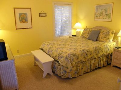 Guest Bedroom Queen with direct access to outside porch. Cable TV/DVD player.