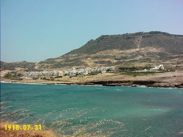 View of Dionysos village from accross the bay