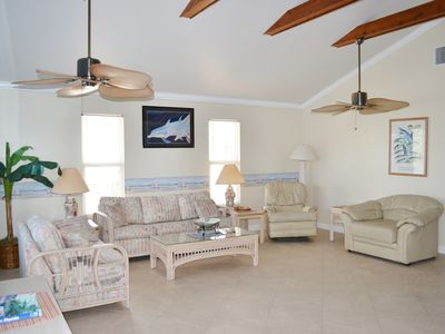 Large Open Living Room and Dining Area including Cathedral Ceilings