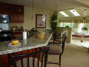 Kitchen, Breakfast Bar, Dining Room & Hot Tub.