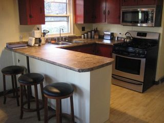 Newfound Lake chalet photo - Kitchen w/ 3 island stools