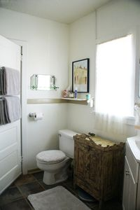 Pristine Jack 'n Jill bathroom with stunning tile, fluffy towels and bath/shower
