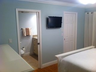 downstairs master bedroom/bathroom and walk-in closet - Indian Shores condo vacation rental photo