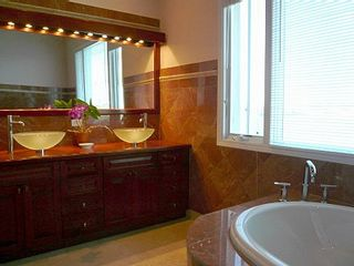 East End villa photo - Rosa Verona marble Master Bath