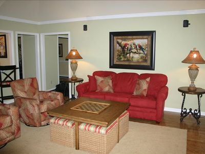 Hang out in 1 of 2 living areas with flat screen TV/DVD, surround sound system