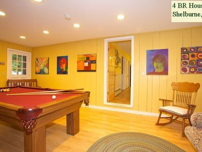 GAME ROOM with full-sized pool table (door to kitchen beyond).