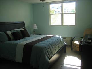 Aguadilla condo photo - Mstr Bdrm: King Size Bed, 40' HDTV, Blue-Ray DVD Player, Cable, darkening shades