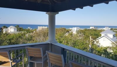 Covered tower deck has seating for 8 and overlooks the gulf and town of Seaside.